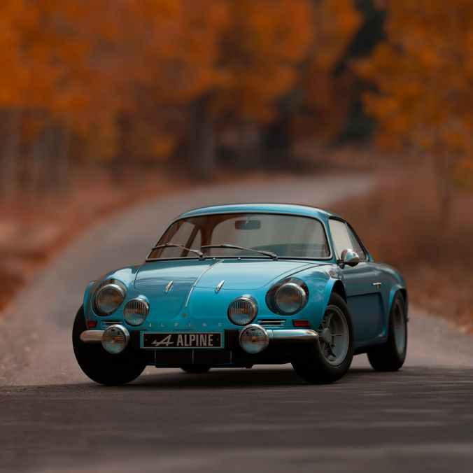 shallow focus photography of blue alpine car
